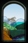 Stain Glass Panel mounted in a window space